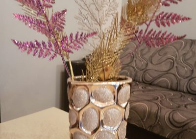 vase with flowers on the living room table