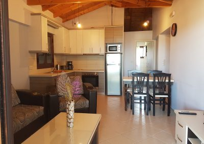 Kitchen and Living room Villa Orestis Rooms Apartments Stoupa